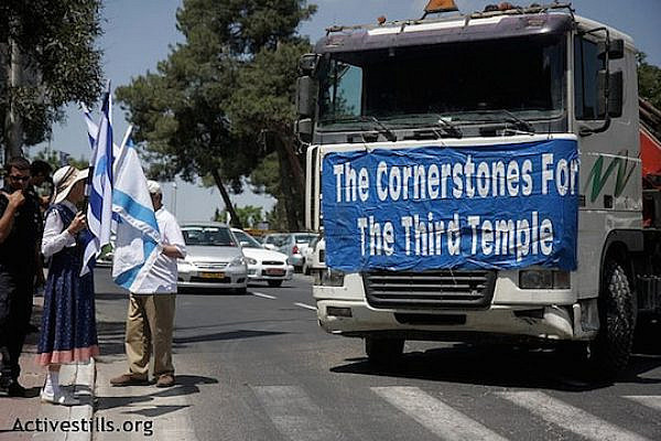 "A Jewish group called ""Temple Mount and Land of Israel faithful movement"" walks through Jerusalem on 21.05.2009. They are followed by a truck which carried stones to be ""the cornerstones of the Third temple."" (Photo by: Anne Paq/Activestills.org)"
