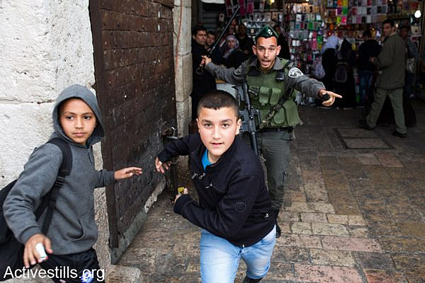 Israeli border police officer chases Palestinian children during land day demonstration in Damascus gate, East Jerusalem on 30 , March 2014 Land Day is held on the anniversary of March 30, 1976, when Palestinian villages and cities across the country witnessed mass demonstrations against the state's plans to expropriate 2,000 hectares of land in Israel's Galilee region. In coordination with the military, some 4,000 police officers were dispatched to quell the unrest. At the end of the day, six Palestinian citizens of Israel were killed by state security forces.