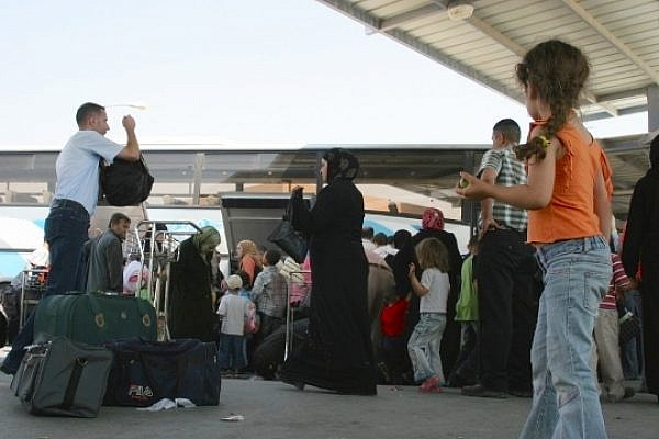 Palestinians wait at the Allenby bridge border crossing. (By Bassam Almohor)