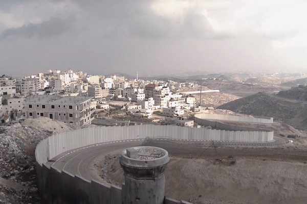 Israel's separation barrier surrounds a Palestinian neighborhood of East Jerusalem. (Screenshot from '3 Houses')