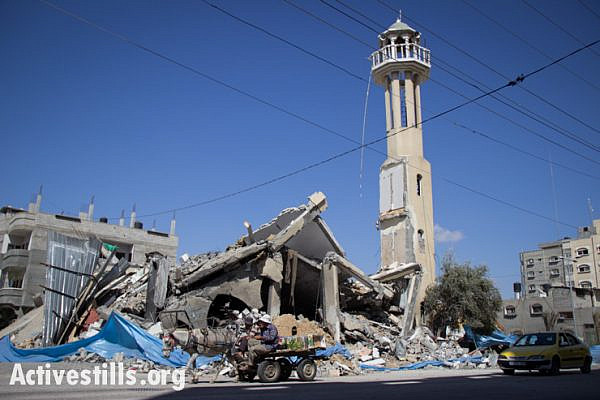 Farouk mosque of an-Nuseirat Refugee Camp lies in ruins after being struck by Israeli bombs, Gaza Srip, July 14, 2014. The mosque was hit two days before.