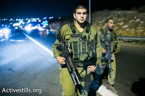 Israeli soldiers near the Palestinian city of Halhul, where the bodies of the three kidnapped Israeli teenagers were found. (photo: Activestills)
