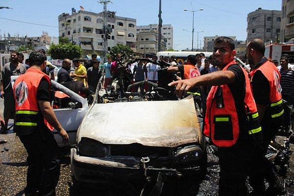 Civil Defense Directorate crews remove the wreckage of a car targeted by an Israeli airstrike in the northern Gaza Strip. The attack killed three men riding in the car who were taken to Kamal Udwan hospital. (photo: Joe Catron/CC BY-NC 2.0)