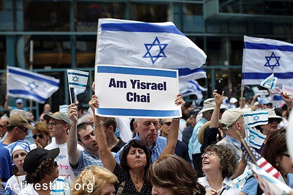 A pro Israeli rally organized by the Israeli consulate in Chicago, IL, on July 22, 2014. At the same time, a protest against the Attack on Gaza was held across the street. (Tess Scheflan/Activestills.org
