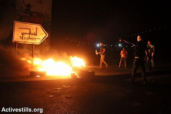 Clashes erupted between hundreds of Palestinians and the Israeli army during a demonstration in Solidarity with the Gaza Strip at Huwwara military checkpoint, Nablus, West Bank in the early morning of July 24, 2014. (photo: Activestills)