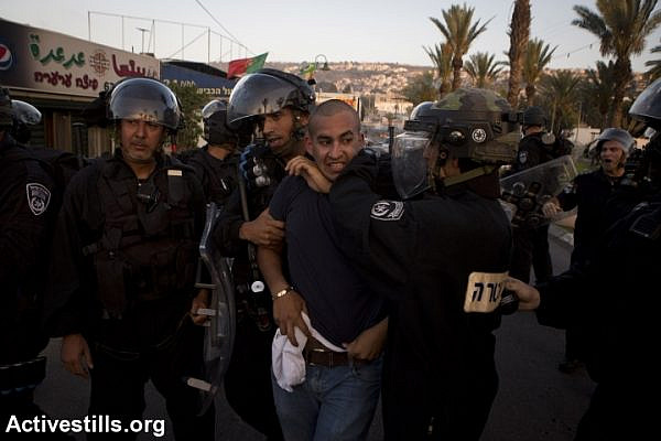 Israeli policemen arrest a Palestinian protestor during clashes in Arara, in Israel's north, in the wake of the murder of 16-year-old Muhammad Abu Khdeir. (photo: Activestills.org)