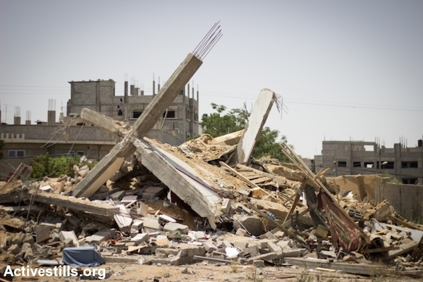 Ruins of the home of Al Haddad family, which was destroyed by an a Israeli drone missile, in Al Shaja'ia neighborhood, Gaza City, July 12, 2014. The family of 25 people evacuated the building before the home was hit. (Photo: Basel Yazouri/Activestills.org)