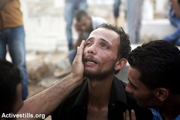 A Palestinian man grieves after an air strike hits his neighborhood in Gaza. (photo: Activestills.org)