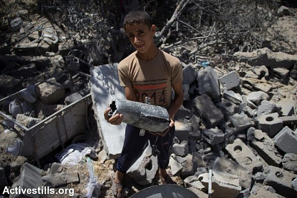 A young Gazan holds the remains of an Israeli missile. (photo: Anne Paq/Activestills.org)