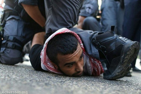 Police arrest a Palestinian-Israeli protester during a demonstration against Operation Protective Edge, July 18, 2014, Haifa, Israel (photo: Activestills)