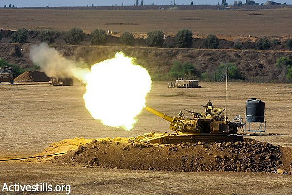 An Israeli artillery unit fires a shell toward the Gaza Strip from its position near the border, July 24, 2014. (Yotam Ronen/Activestills.org)