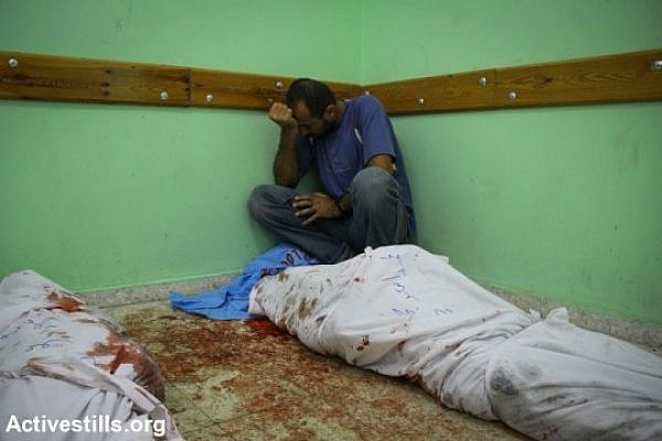 Bodies lie on the floor of Kuwaiti Hospital after Israeli attacks in Rafah, Gaza Strip, August 3, 2014. Since Al Najjar Hospital was closed, Kuwaiti, a nearby private hospital, opened its doors for emergency cases. So far, Israeli attacks have killed at least 1,676 Palestinians, including 378 children (photo: Activestills)