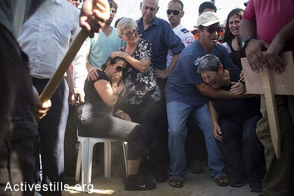 Family members and relatives of Daniel Tregerman, a 4-years old, mourn during his funeral on August 24, 2014 in Hevel Shalom, Israel. (Activestills.org)