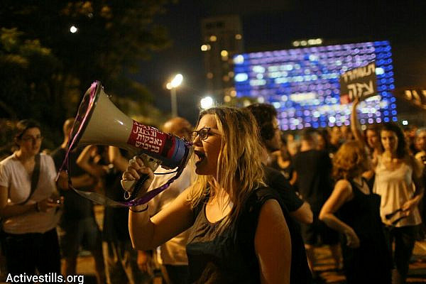Hundreds gather in Tel Aviv to protest Israel's Operation Protective Edge, despite a police decision to revoke the demonstration's permit, Rabin Square, Tel Aviv, July 9, 2014 (photo: Activestills)