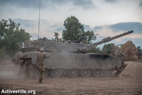 Israeli tanks on the Israel-Gaza border. (photo: Activestills.org)