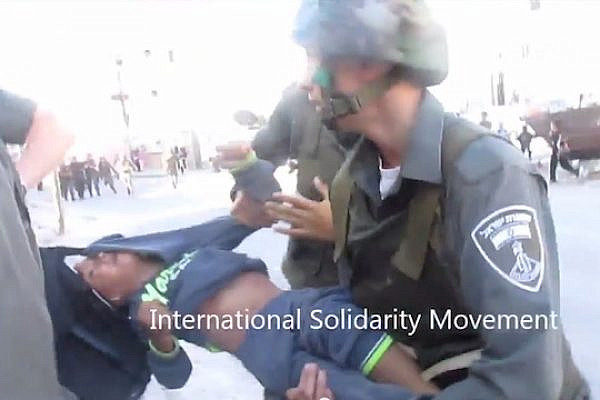 A 7-year-old Palestinian boy is detained by Israeli Border Police officers in Hebron. (Screenshot: ISM)