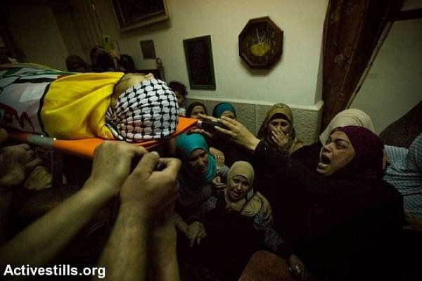 Palestinians carry the body of Eissa al-Qotri during his funeral at the Al-Amari refugee camp near the West Bank city of Ramallah, September 10, 2014. Al-Qotri was killed by the Israeli army early on September 10, 2014 during clashes between Palestinians and Israeli soldiers after the Israeli army raided the camp. (photo: Faiz Abu Rmeleh/Activestills)