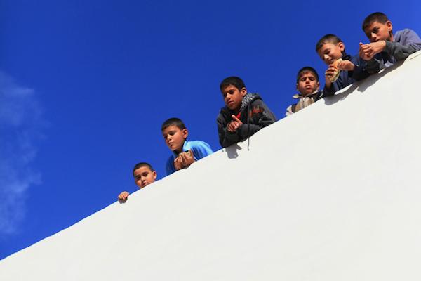 Palestinian children on a rooftop in East Jerusalem. (Anne Paq/Activestills.org)