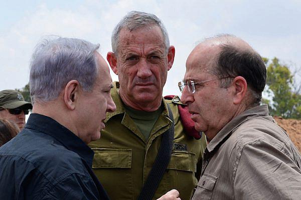 Israeli Prime Minister Benjamin Netanyahu with IDF Chief of Staff Benny Gantz and Defense Minister Moshe Ya'alon. (Photo by Kobi Gideon / GPO)