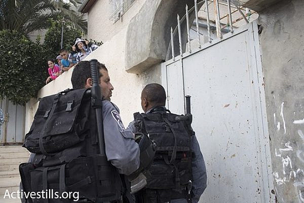 Israeli riot police at the entrance to the Hayat family home, September 30, 2014. (Photo by Oren Ziv/Activestills.org)