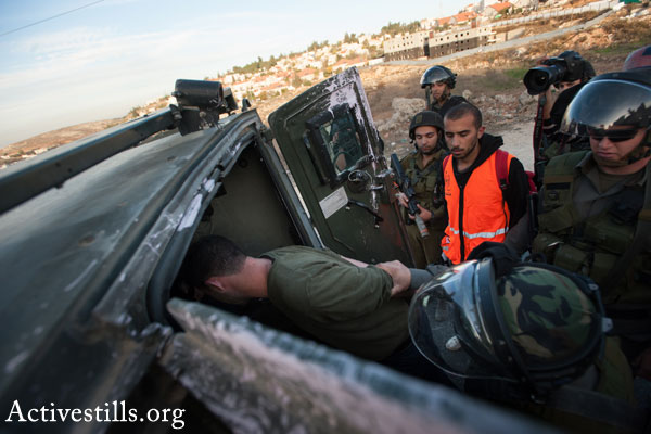 Illustrative photo of Israeli soldiers arresting a Palestinian man (Activestills.org)