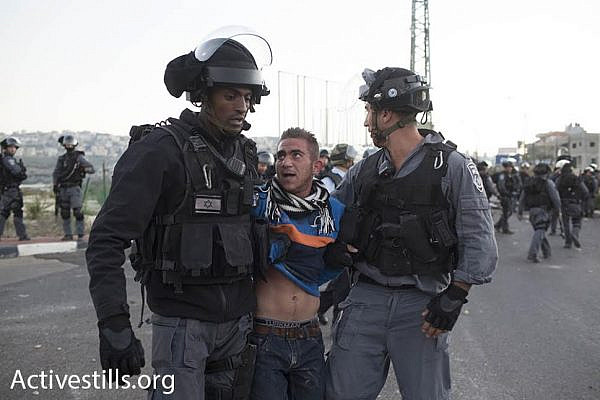 Police arrest a young protester during clashes in Kafr Kanna. (photo: Oren Ziv/Activestills.org)
