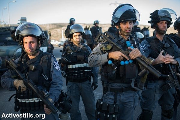Israeli riot police pictured during clashes in Kafr Kanna, in the wake of the shooting death of Khir Hamdan. (photo: Yotam Ronen/Activestills.org)