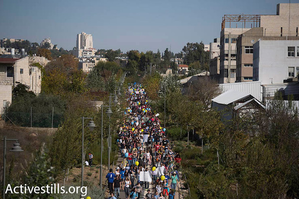 """Thousands of people march through Jerusalem in support and solidarity with the Max Rayne """"Hand in Hand"""" bilingual school, which was the target of a racist arson attack a week earlier, Jerusalem, December 5, 2014. (Photo by Oren Ziv/Activestills.org)"""