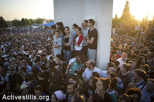 Family and friends of Eyal Yifrah, Gilad Shaar, and Naftali Fraenkel, three Israeli teenagers who were abducted and killed in the West Bank, take part in their funeral in the city of Modi'in, Israel, Tuesday, July 1, 2014. (Oren Ziv/Activestills.org)