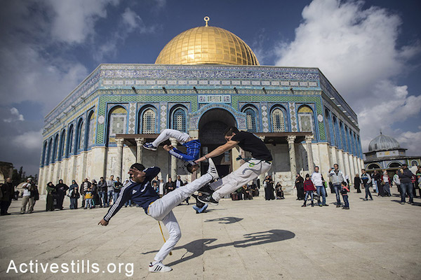 Palestinian youth preform a Capoeira session in front of Al Aqsa mosque, November 22, 2014. Faiz Abu-Rmeleh/Activestills.org