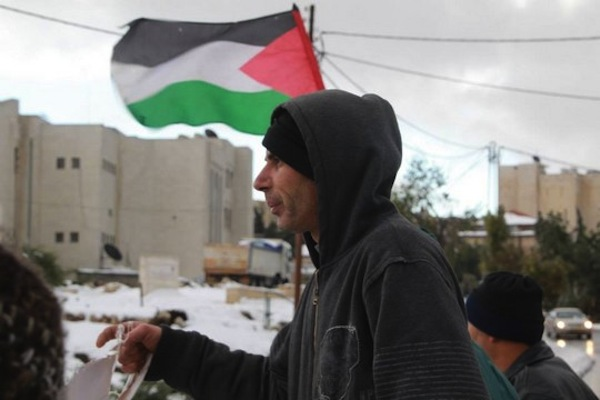 Salah Diab, a leader of the popular struggle in Sheikh Jarrah, during a weekly protest in the neighborhood. (photo: Amir Bitan)