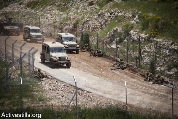 File photo of Israeli soldiers patrolling the northern border. (Photo by Oren Ziv/Activestills.org)