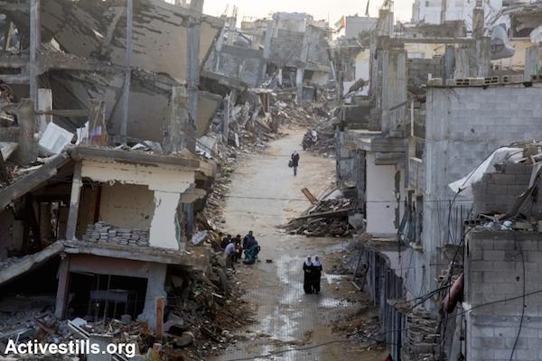 Palestinian school girls walk across a destroyed part of Shujayea neighborhood, Gaza city, November 4th, 2014. (Photo by Anne Paq/Activestills.org)