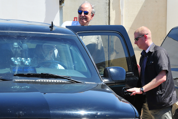 Then American Mideast peace envoy George Mitchell exits an armored diplomatic vehicle at the Kerem Shalom crossing between Israel, Gaza and Egypt, June 30, 2010. (Photo by ChameleonsEye/Shutterstock.com)