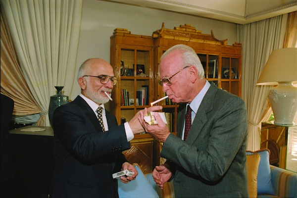King Hussein of Jordan lights Prime Minister Yitzhak Rabin's cigarette at the Royal Residence in Aqaba, Jordan, shortly after signing the peace treaty at the Arava Border Crossing. (photo: GPO)