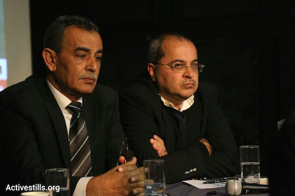 Balad head MK Jamal Zahalka (left) and Ta'al head MK Ahmad Tibi, February 11, 2014. (Photo by Activestills.org)