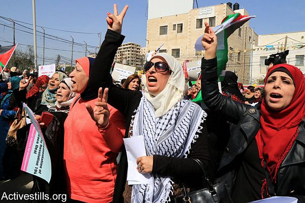 Palestinian women march toward the Qalandia checkpoint separating Ramallah and Jerusalem. Israeli soldiers broke up the joint Israeli-Palestinian protest against the occupation, a day before International Women's Day, March 7, 2015. (Ahmad Al-Bazz/Activestills.org)