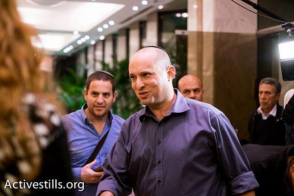 Jewish Home chairman Naftali Bennett campaigning. (Yotam Ronen/Activestills.org)