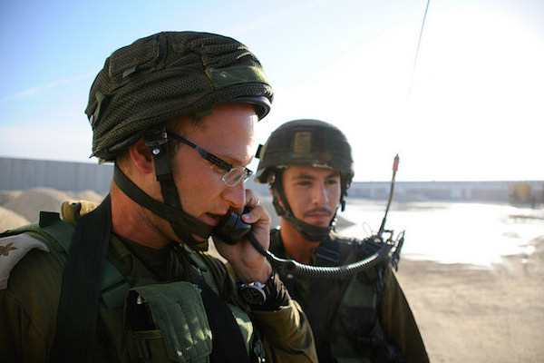 An Israeli soldier uses a two-way radio during an exercise during the Gaza border, November 19, 2014. (Amit Shechter/IDF Spokesperson)