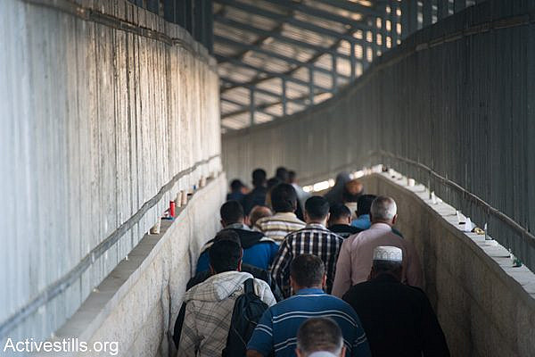 Palestinians enter the main checkpoint separating Bethlehem and Jerusalem. (Activestills.org)