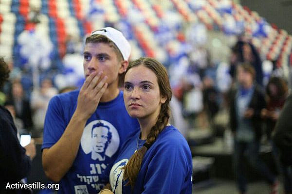 Zionist Camp supporters listen to exit poll results, Tel Aviv, March 17, 2015. (Oren Ziv/Activestills.org)
