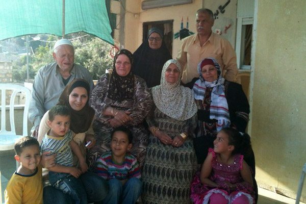 The Ruweidi family outside their home in Silwan May 9, 2012 (Photo: Moriel Zecher-Rothman)