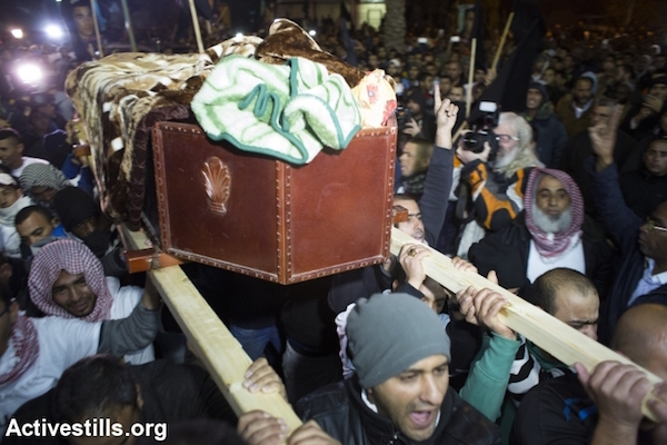 Mourners carry the body of Sami al-Jaar during his funeral, in the city of Rahat, Negev Desert, January 18, 2015. (Photo by Oren Ziv/Activestills.org)