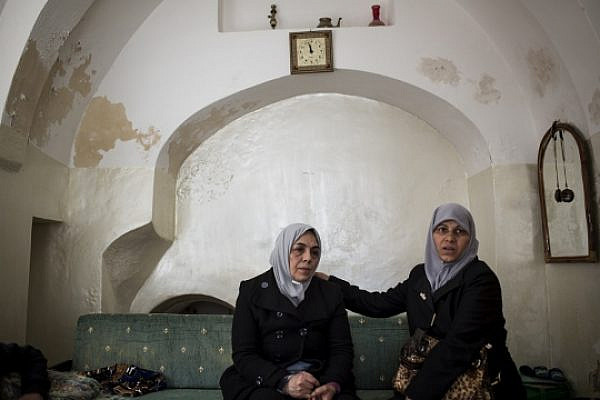 Women from the Sub Lahan family sit in their family home, Old City of Jerusalem. (photo: Tali Mayer/Activestills.org)