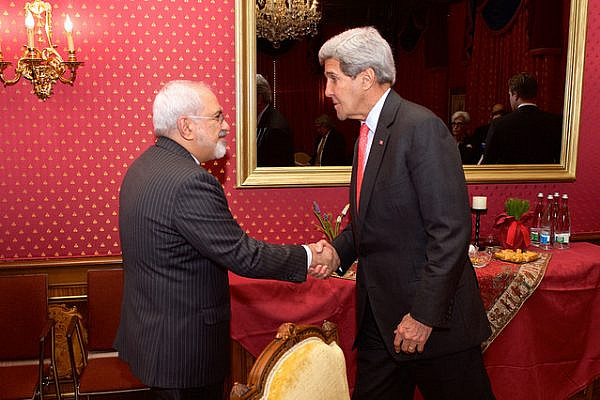 U.S. Secretary of State John Kerry greets Iranian Foreign Minister Javad Zarif on March 20, 2015, in Lausanne, Switzerland, before their advisers resumed negotiations about the future of Iran's nuclear program. (State Department photo)