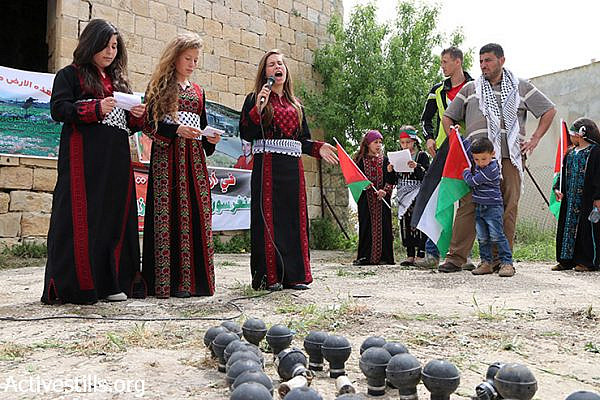 Palestinian children sing during a demonstration marking Land Day in Nabi Saleh village, West Bank, March 28, 2015. Land Day is held every year to mark the deaths of six Palestinians protesters at the hands of Israeli police and troops during mass demonstrations on March 30, 1976, against plans to confiscate Arab land in Galilee. (photo: Activestills.org)