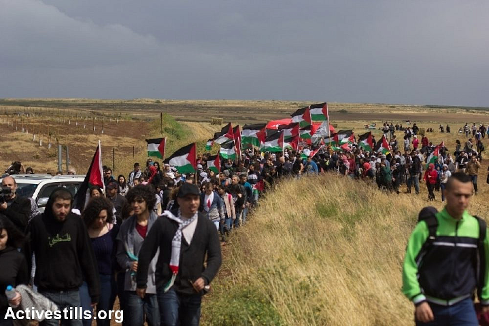 Thousands of Palestinian citizens of Israel take part in March of Return to the destroyed village of Hadatha, near Tiberias, April 23, 2015. (Activestills)