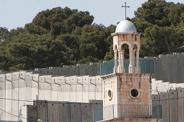 Church based activists in the U.S. are listening to their Palestinian Christian counterparts. Here, the Greek Orthodox Church of Saint Lazarus rises near the Israeli Separation Wall dividing Palestinian neighborhoods on the Mount of Olives in East Jerusalem. (photo: Ryan Rodrick Beiler/Activestills.org)