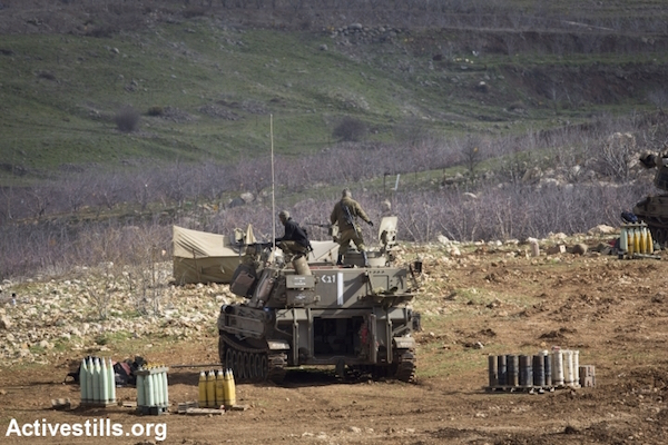 Israeli tanks are positioned along the Syrian border in the occupied Golan Heights, January 29, 2015. (Photo by Oren Ziv/Activestills.org)