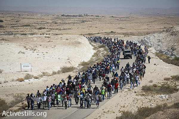 African asylum seekers march from the Holot detention facility toward the Egyptian border.